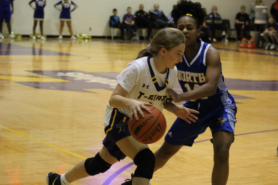 Brute Force. Sophomore Alyssa Fjelstad runs through a player from Omaha North.