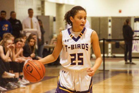 Dribble. Sophomore Taryn Wharton comes down the court.