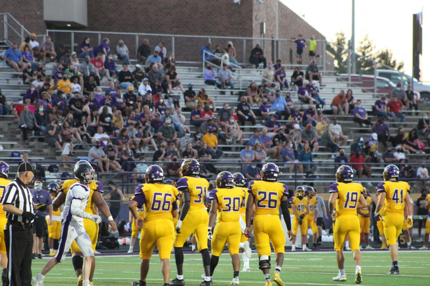 The defensive line sets up for a play at the East West football game on Sept. 4, 2020.