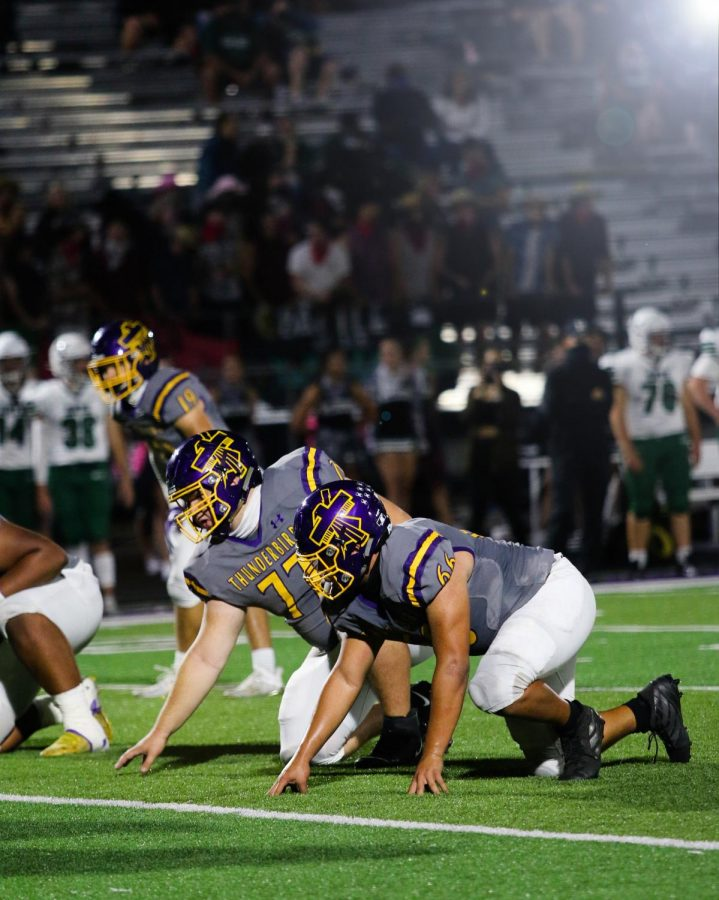 Junior lineman Arden Jenkins and sophomore lineman David Waller get ready for the play.