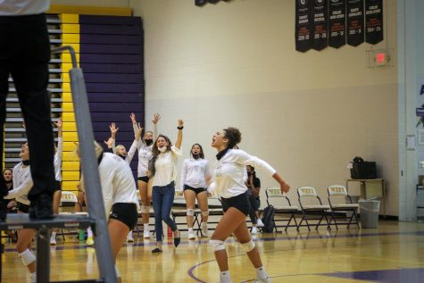 Sophomore Destiny Ndam-Simpson celebrates with the volleyball team during the Bellevue West vs Millard West on Sept. 24, 2020.