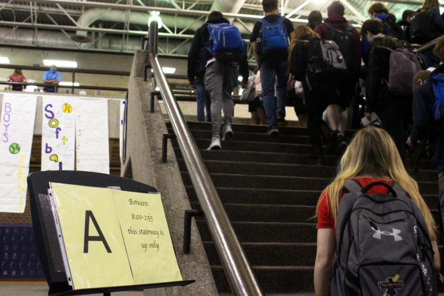 Students walk up the commons stairs at the beginning of an A day.