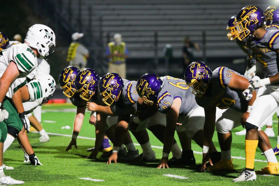 The offensive line gets set for the snap.