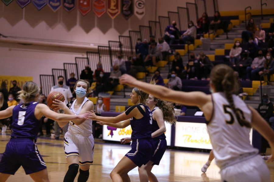 Sophomore Emma Crisman looks to pass to sophomore Dani Peterson.
