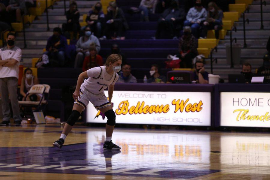 Sophomore Alyssa Fjelstad eyes down a Grand Island player on defense.