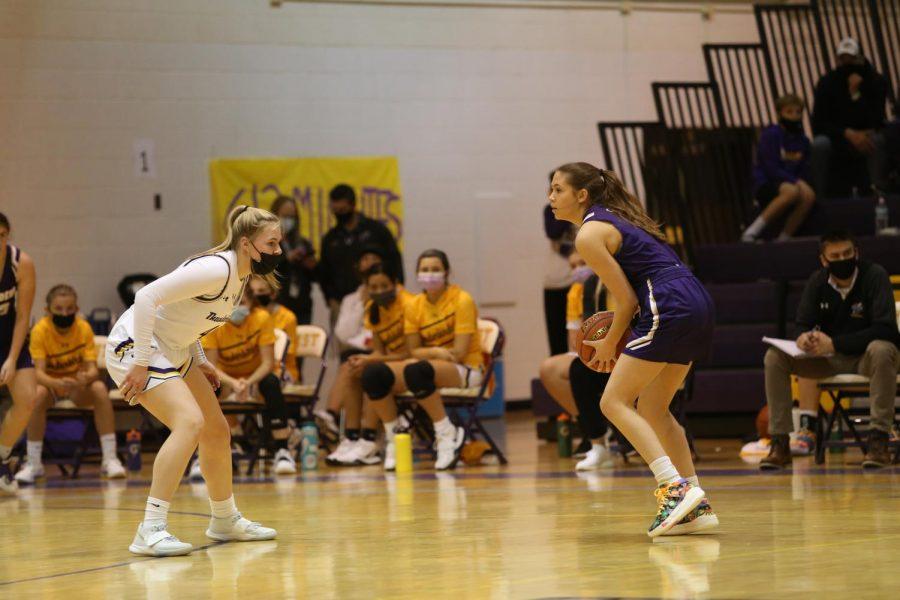 Freshman Kenzie Melcher covers a Grand Island player on defense.