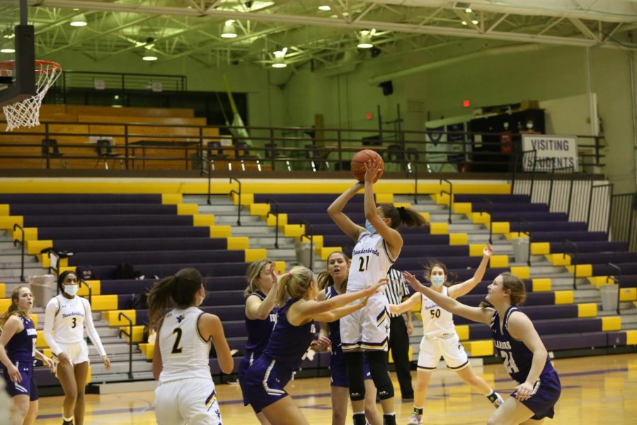Sophomore Taryn Wharton hits an shot from the inside.