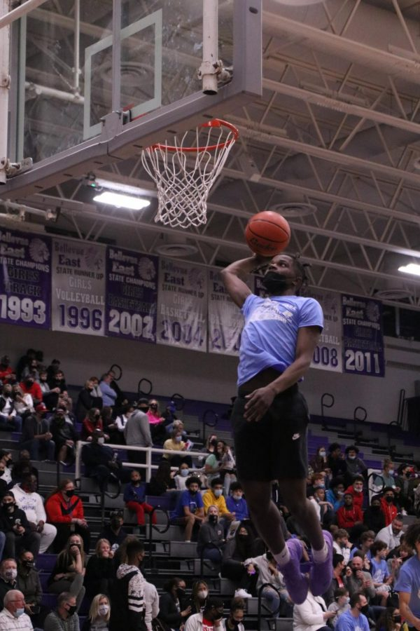 Omaha Central's Denim Johnson gets up for a dunk.