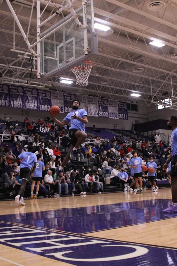 Bellevue West's Greg Brown dunks during the warm-up.