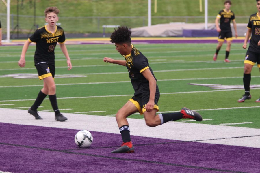 Freshman Octavio Miranda rushes to keep the ball in-bounds.