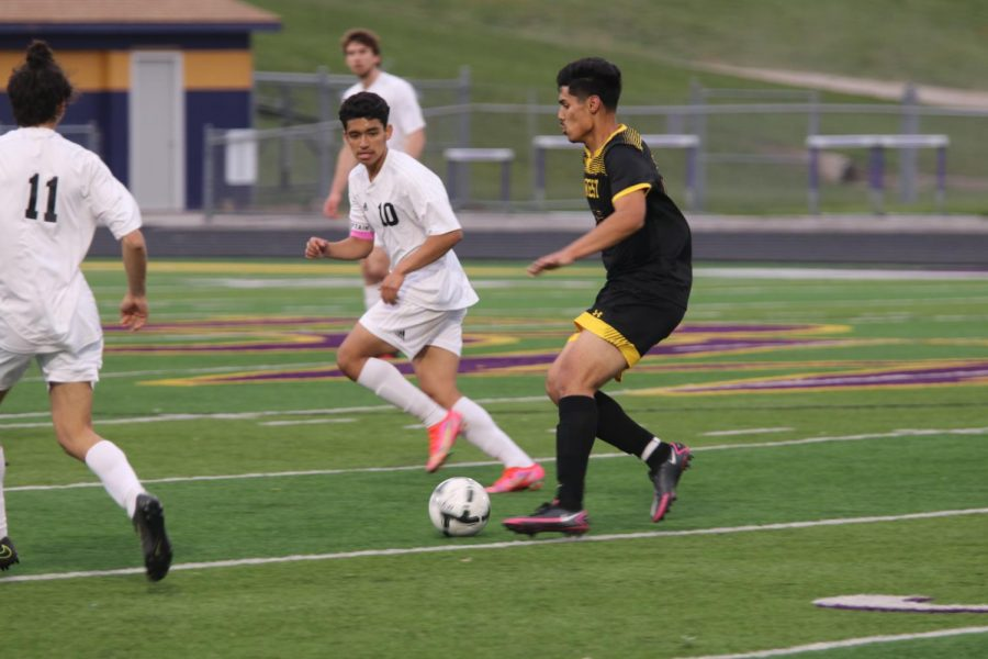 Senior Martin Fuentes prepares to pass.