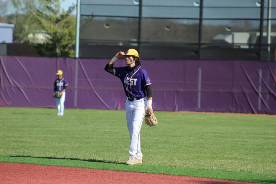 Senior Jaden Holman watches for a hit in the outfield.