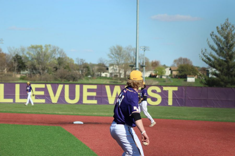 Senior Carson Wright plays catch in between innings.