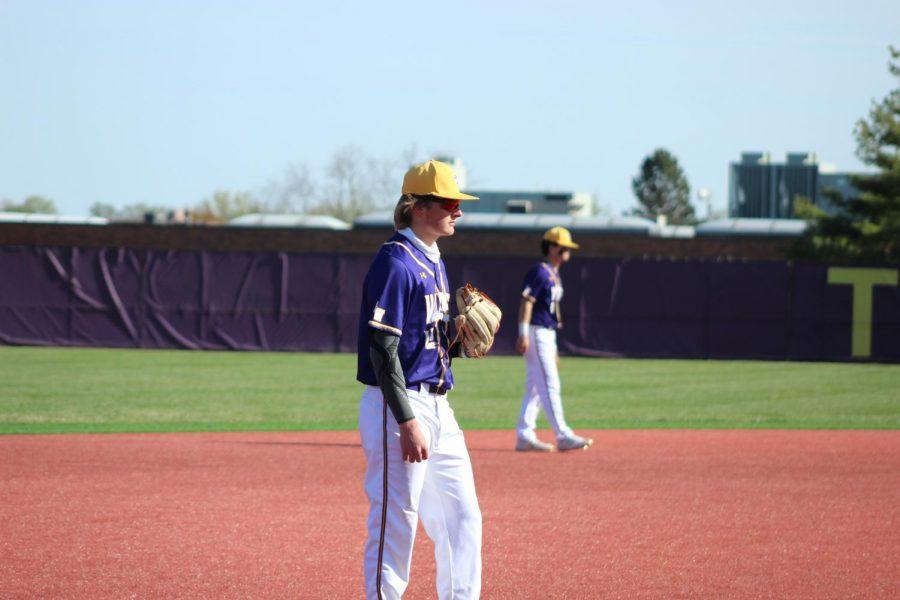 Senior Gage Allen anticipates the hit while playing third base.