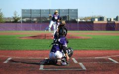 Freshman Cade Zavala catches a practice throw by Jack Bland.