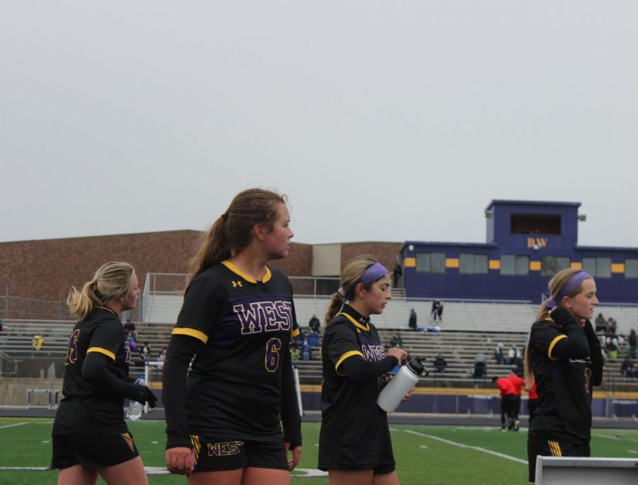 Juniors Sophie Goessling and Katelyn Fjelstad and Sophomores McKenna Blackburn and Faith Proksel watch the action downfield.