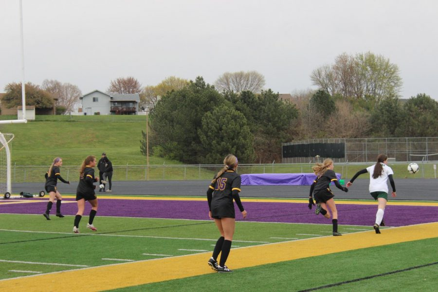 Freshman Mia McVay runs after a Gretna player.