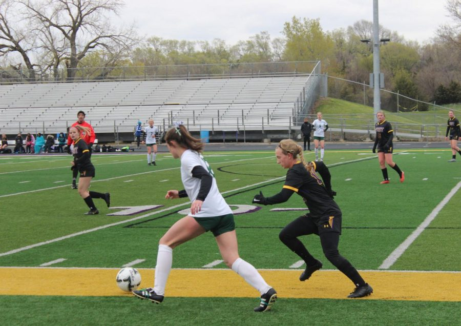 Junior Alyssa Fjelstad chases a Gretna player for the ball.