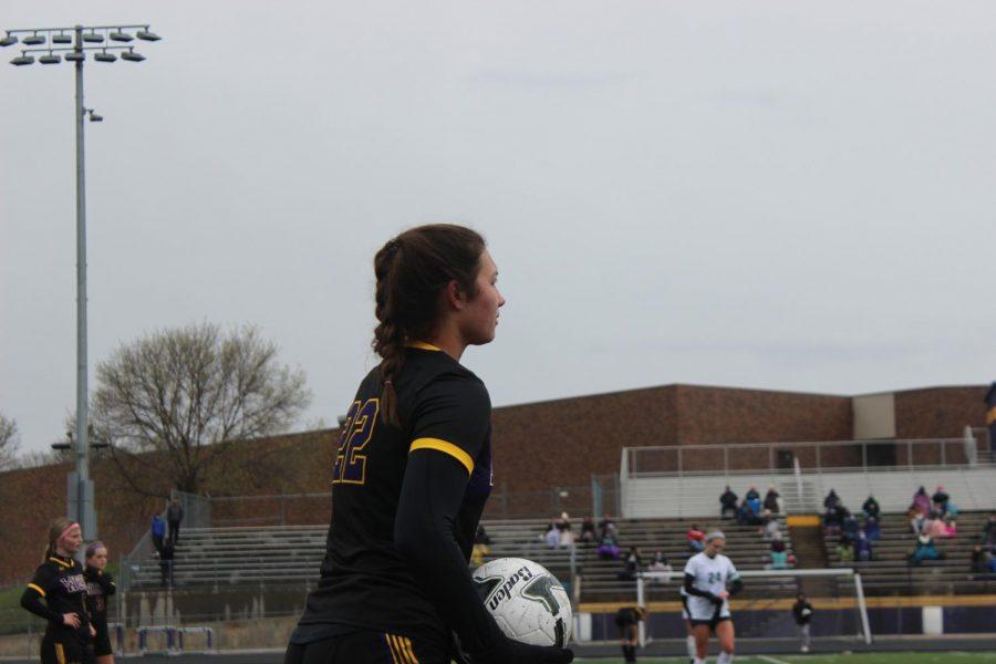 Junior Reece Flores prepares to throw the ball in.