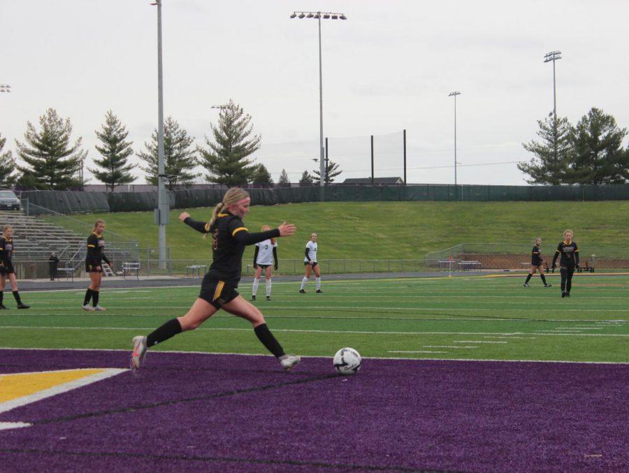 Junior Kimmee Davenport takes a goal kick.