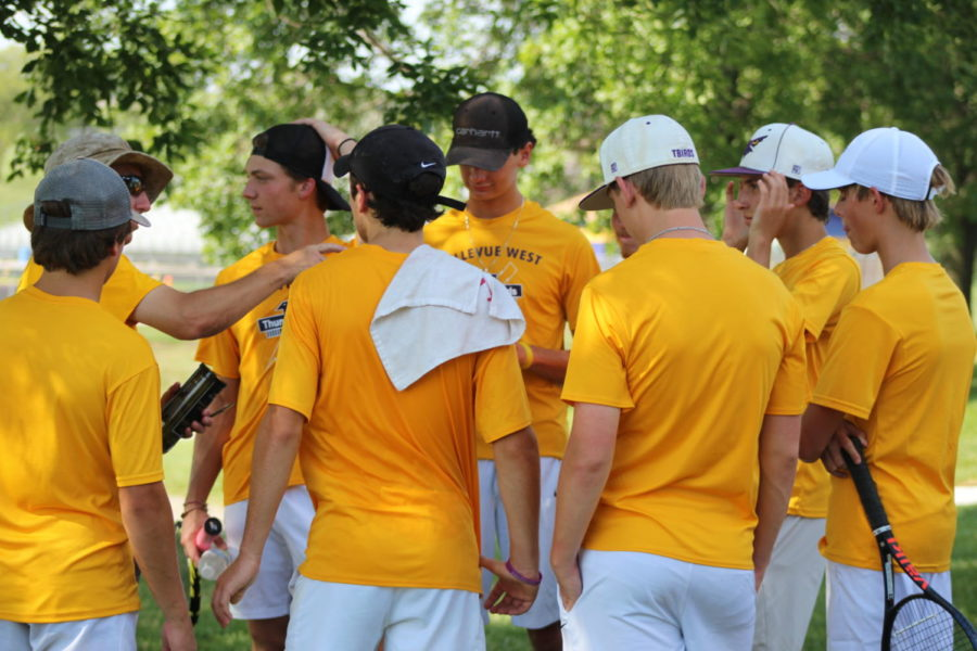 Coach Steve Lemon prepares the boys tennis team for upcoming matches against Gross High School.