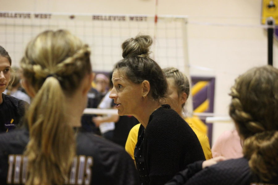 Volleyball Coach Christina Krajicek talks to the team during a timeout.