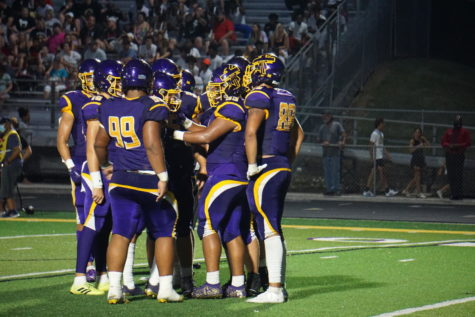 The Bellevue West offense strategizes during the Burke game on Aug. 26, 2021.