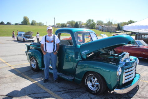 Owner Tim Evers poses in front of his GMC, 1950 pickup truck.